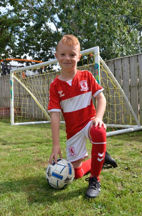 YOUNG STAR: Keiron Robinson, 7, practising in his Middlesbrough kit