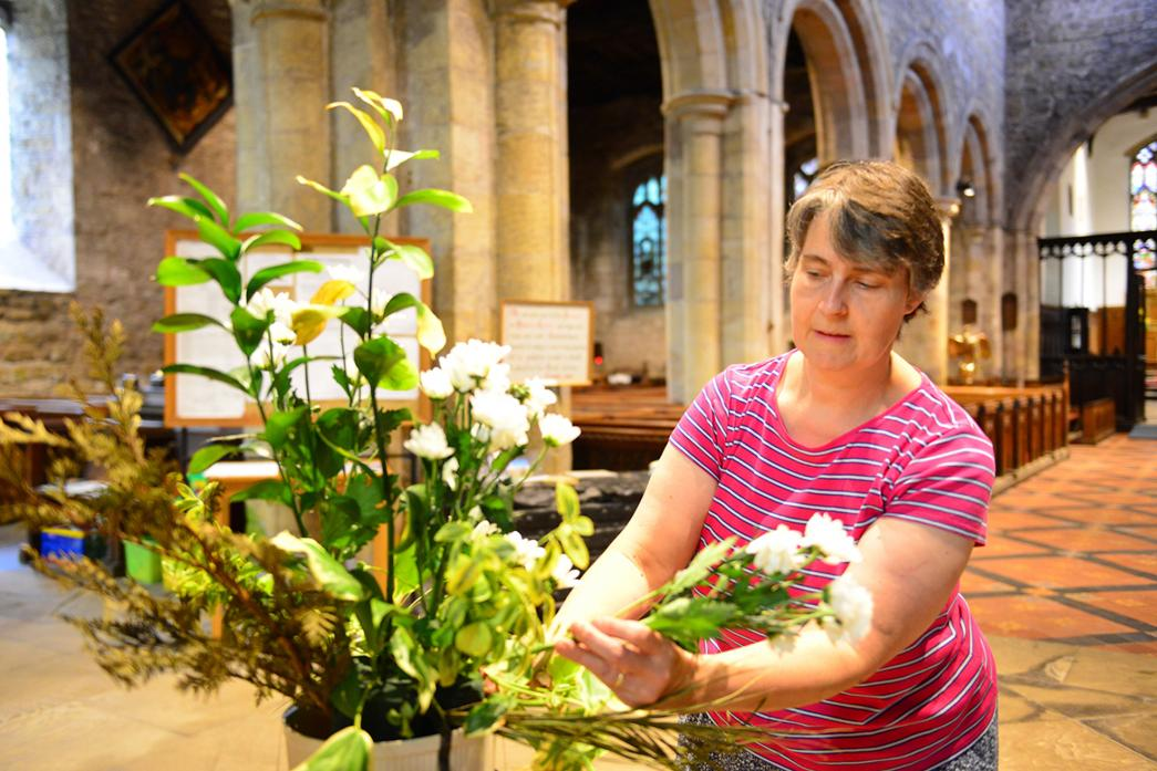 BLOOMING LOVELY: Mary Steventon preparing a flower arrangement at Staindrop's St Mary the Virgin Church