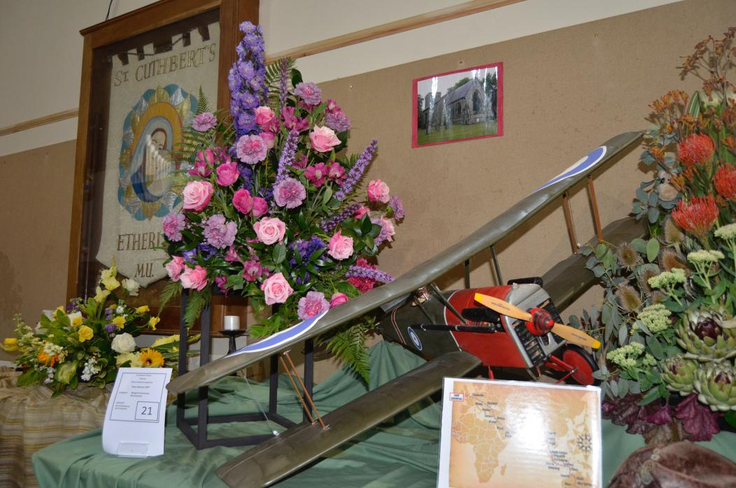 IN BLOOM: Above, Amy Johnson's epic flight honoured in floral display by Margaret Henderson and Rita Goundry