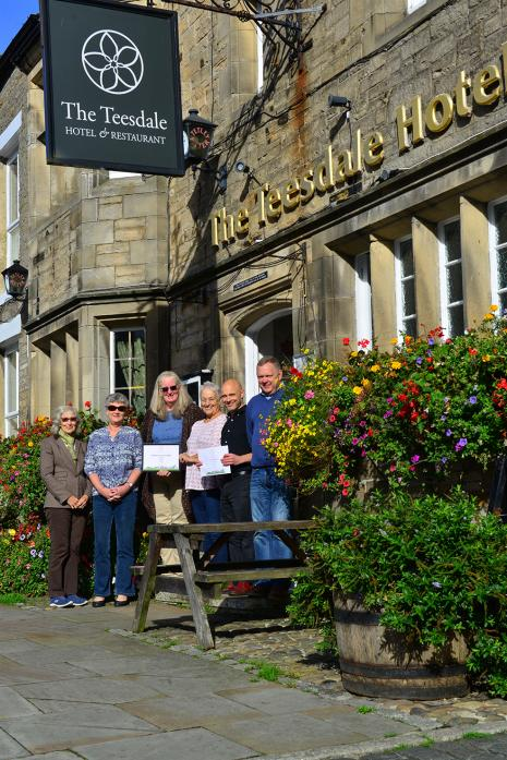 COMMUNITY EFFORT: Suzanne McBain, Lindsey Pepall, Jill Savage, Pam Phillips, Dave Falconer and Andy Mitchell showing off the multiple gold awards won by their village in the Northumberland in Bloom competition