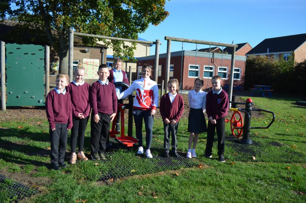 KEEP FIT: Pupils at Oakley Cross Primary School marked the opening of their new outdoor gym with a visit from Olympic weightlifter Kelly-Jo Robson