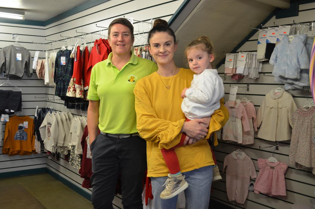WORKING TOGETHER: Lauren Franklin has opened up Kiddywinkles Childrenswear inside Connelly's Toyshop, in Barnard Castle. She is pictured with youngest daughter Thea and toyshop owner Pauline Connelly