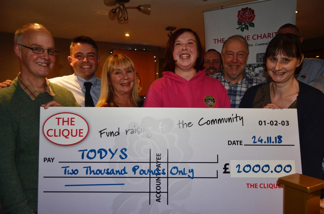 ALL SMILES: TODYS picked up £2,000. From left, Gordon Thompson, Matthew Croom, Claire Tobbell, Laura Patterson, Neil Baker and Karen Jackson