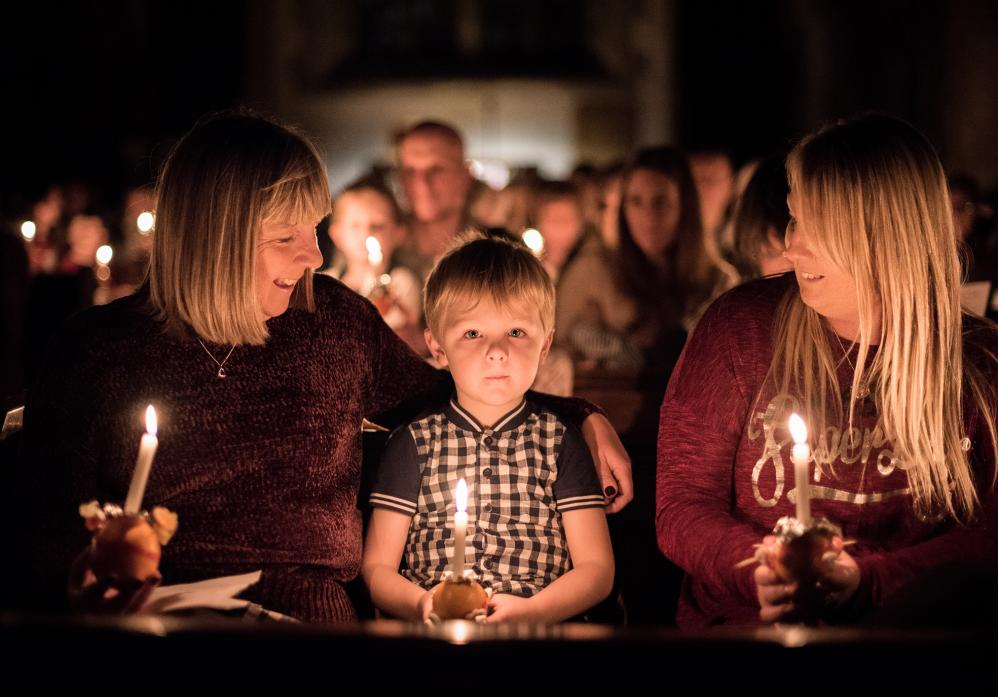 LIGHT SHOW: Lizzie and Chloe Allinson with little Logan and their Christingles
