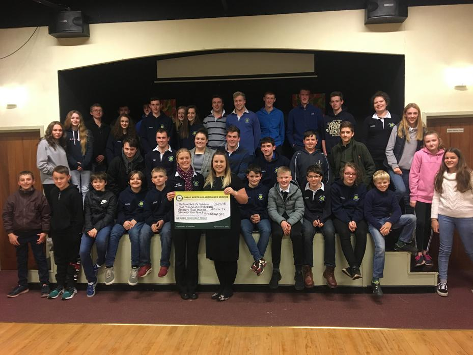 FLYING HIGH: Members of Staindrop Young Farmers' Club present a cheque for more than £1,500 to Joanne Murphy, of the Great North Air Ambulance Service