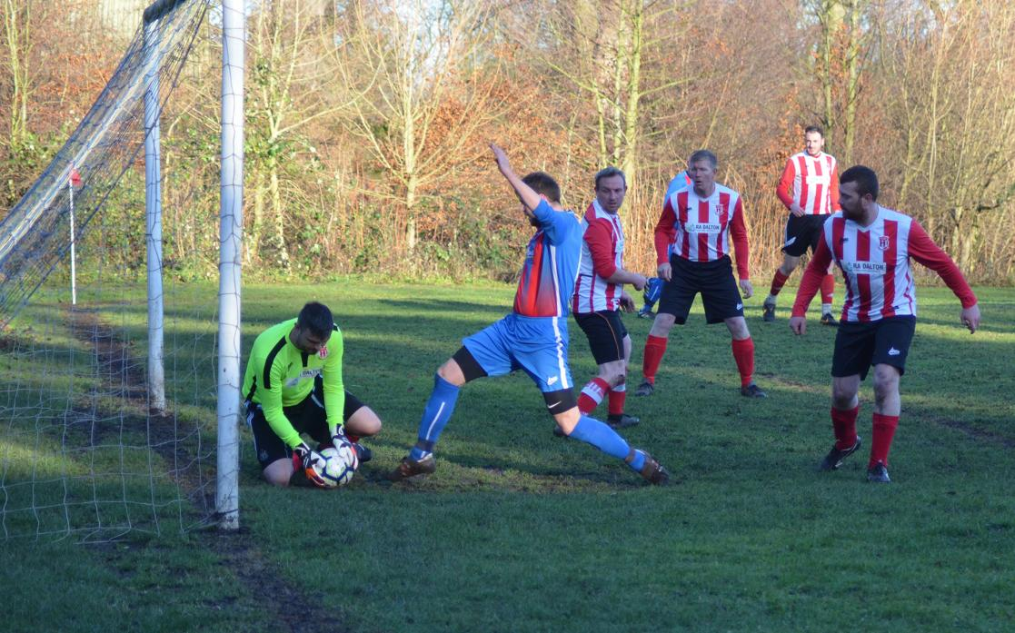 LUCKY BREAK: Jonny Raine's challenge on the Wearhead keeper was a split second too late – but when he bundled the ball over the line, inset, the ref let the goal stand