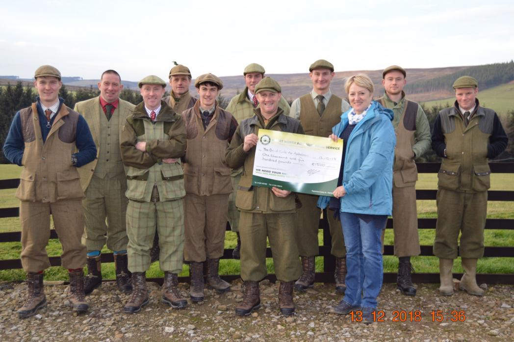 RURAL SUPPORT: Anne Lipscombe, of the Great North Air Ambulance Service, receives £1,500 from game keepers from Teesdale and Weardale