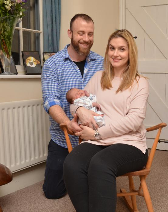PERFECT GIFT: Proud parents Charlie and Verity Terry pose with daughter Jemima Ophelia Rose, who was born at 11.53pm on Christmas Day. The couple had enjoyed Christmas lunch with Mr Terry's parents before his wife went into labour in the evening