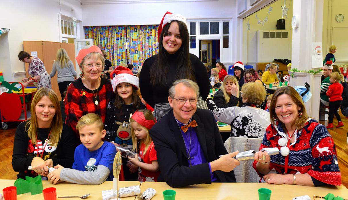 CHEERIO:  Butterknowle Primary School head Tessa Fenoughty, right, is all smiles as Kirsty Henderson, Alex Peneycad, Margret Ostle, Monique Nichols, Emilia Peneycad, Bishop Paul Butler and Lori Cook say goodbye at her final Christmas lunch