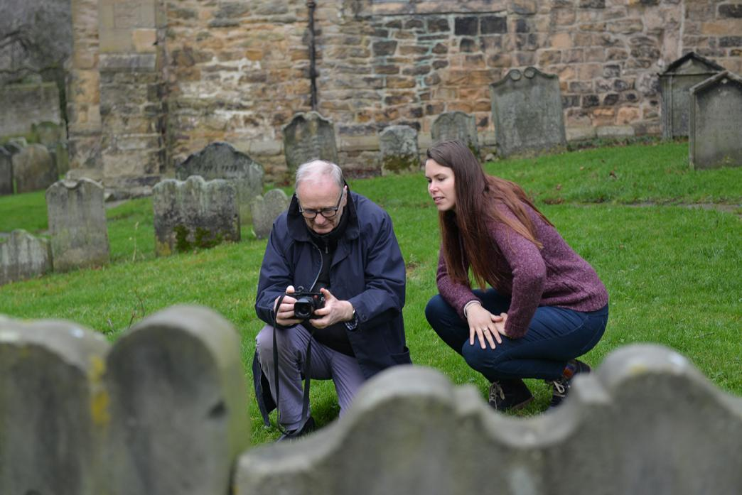 TOWN HERITAGE: Community archaeologist Johanna Ungemach gives advice to Douglas May as he takes photographs with the aim of making a 3D model of gravestones in the grounds of St Mary's Church. Below, head of field archaeology for DigVentures Chris Casswel