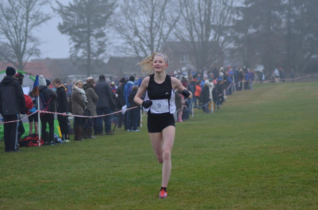 ALL SMILES: Ex-Barnard Castle School student India Pentland is all smiles as she wins the senior girls' cross country title on Saturday. Now at Carmel College sixth form, she was running for Darlington