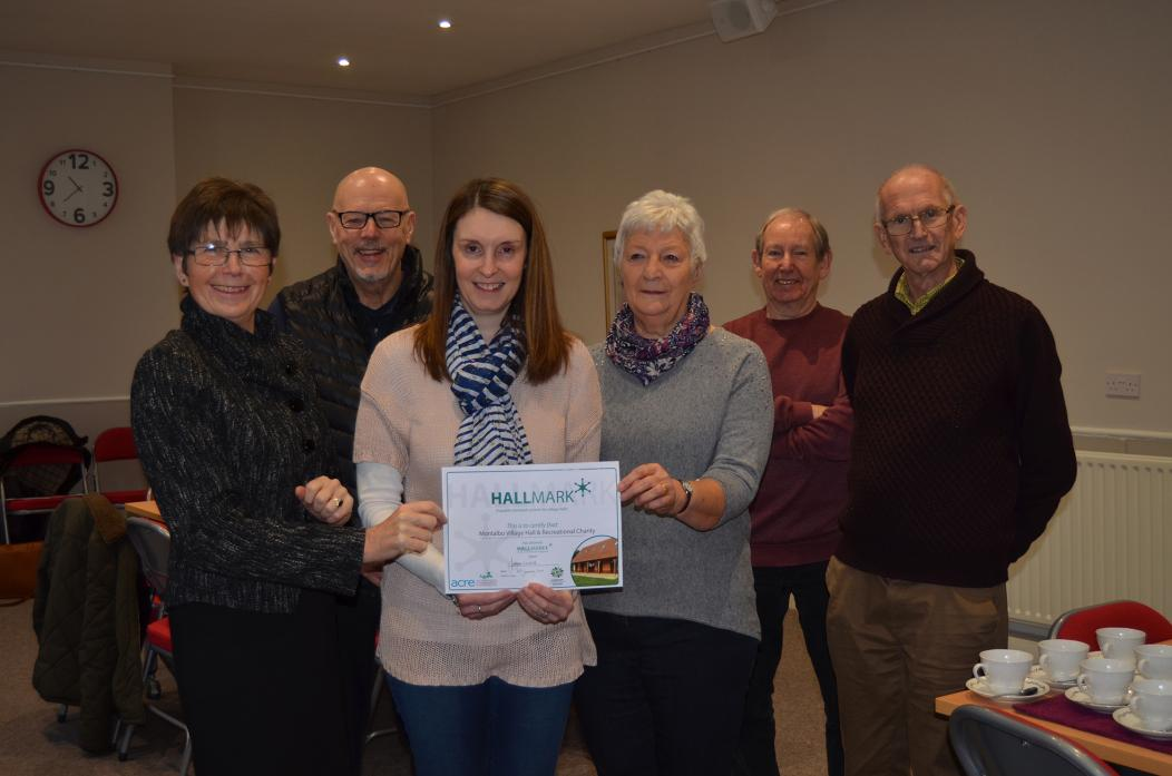 QUALITY COUNTS: Volunteer committee members from Gainford Village Hall were awarded a Hallmark accreditation award. From left, Amanda Thomas, Billy Barnett, Helen Brown, of Durham Community Action, Kathy Russell, Peter Dransfield and Neil Russell.