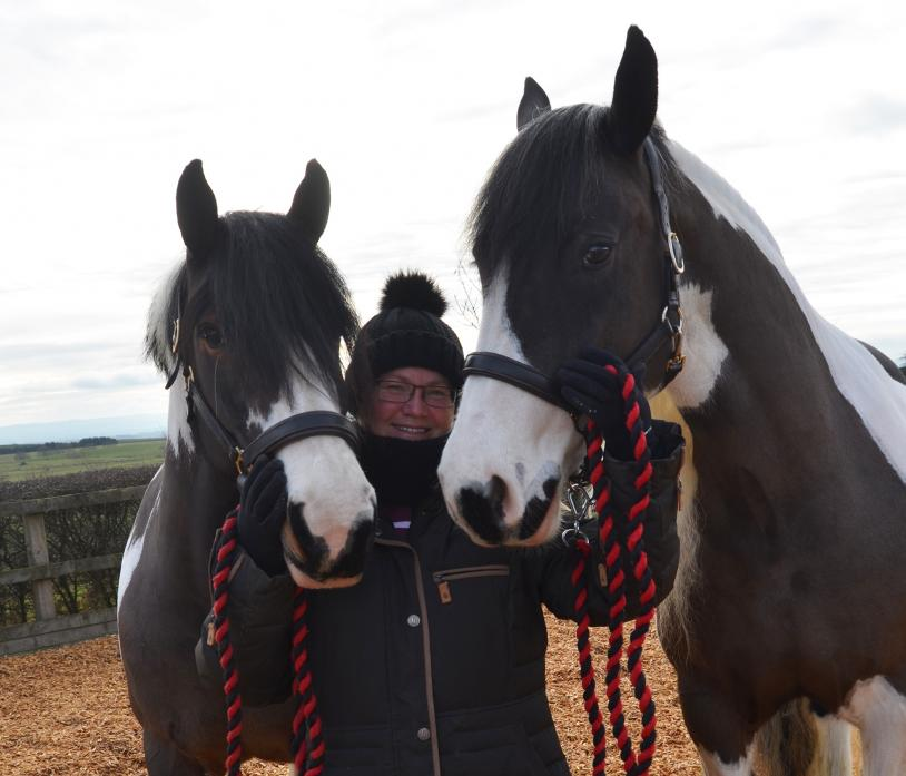IN THE SADDLE: Nicki Stanier with her beloved horses Red Rose and Lillie. She aims to ride 500 miles on them to raise funds for Cancer Research UK.