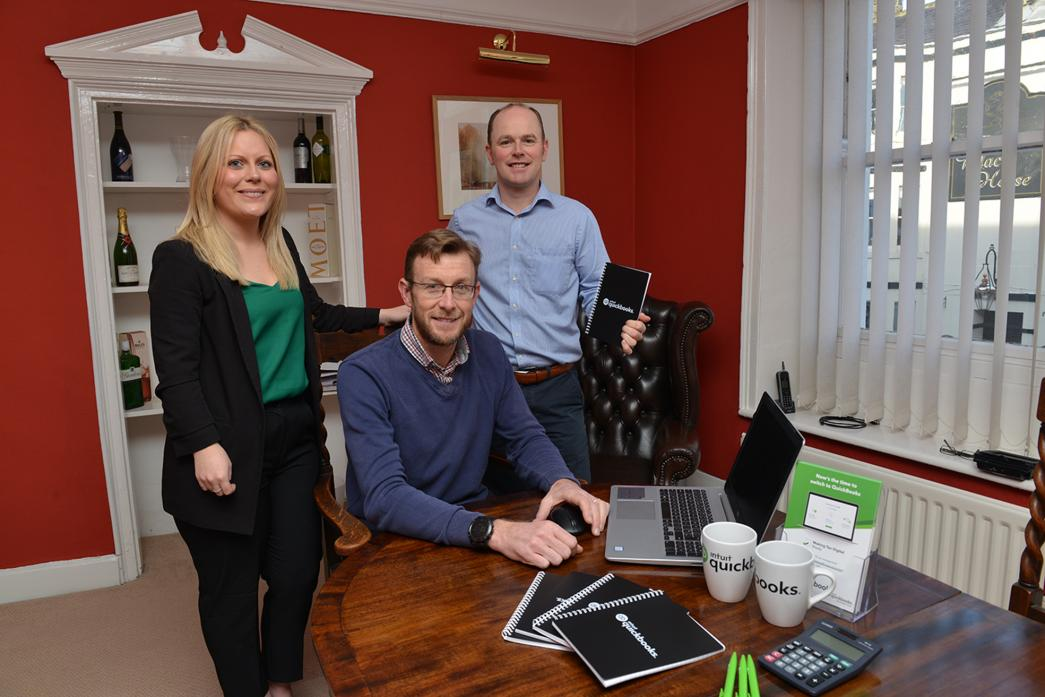 DIGITAL REVOLUTION: Directors Chris Butler and Darren Gee with QuickBooks regional development manager Kelly Hurst