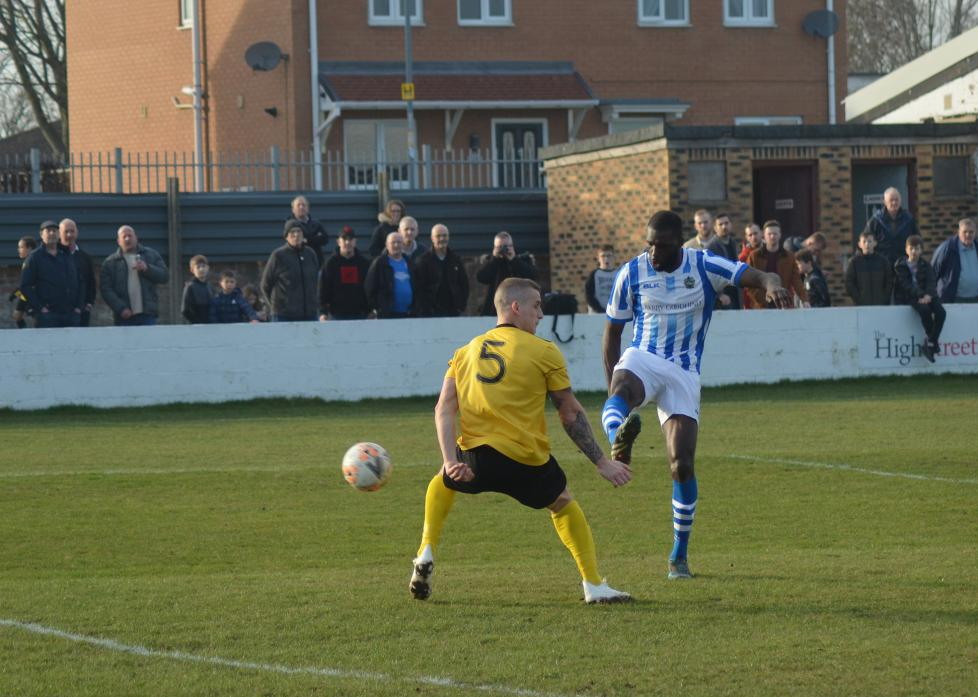 BLOW: Chertsey's Quincey Rowe blasts his side's second goal