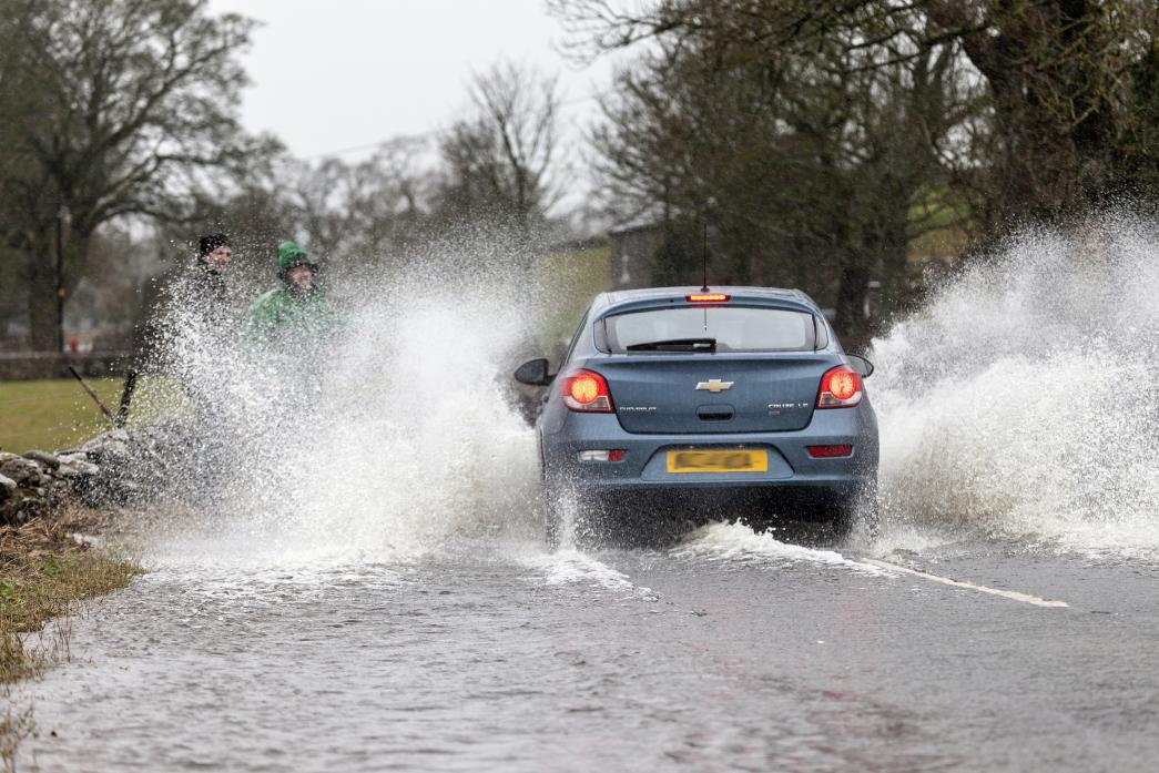 WET, WET, WET: A car splashes through the flooded  road at Newbiggin on Saturday – council chiefs are being called on to do more to  stop the reoccurring problem