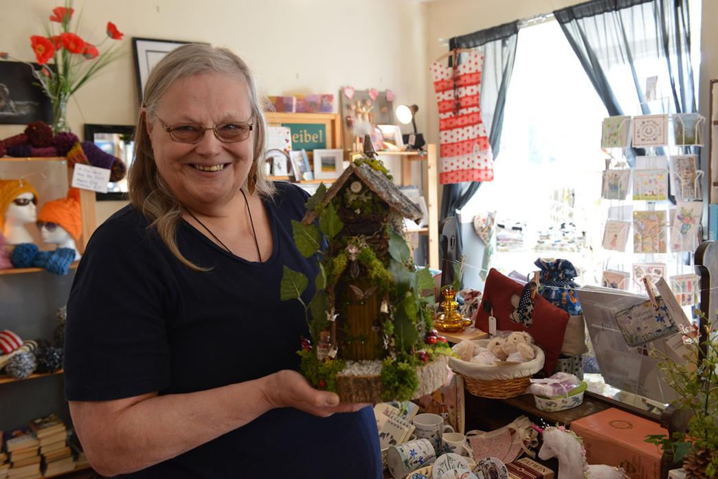 CRAFTY MOVE: Jane Addison with one of the new fairy houses on sale at Fresh Crafts and Interiors