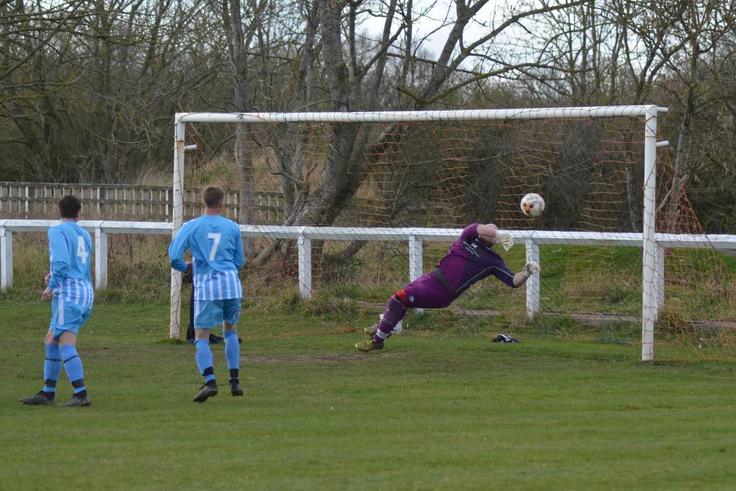 NO WAY PAST: Evenwood keeper Mark Tyrie at full stretch to keep out this free kick