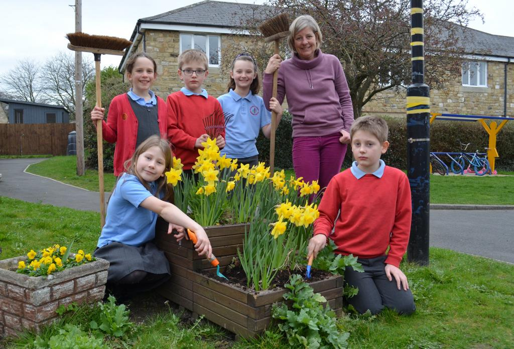 TAKING ROOT: Yvonne Arkley and members of the St Mary's RC School lunchtime gardening group