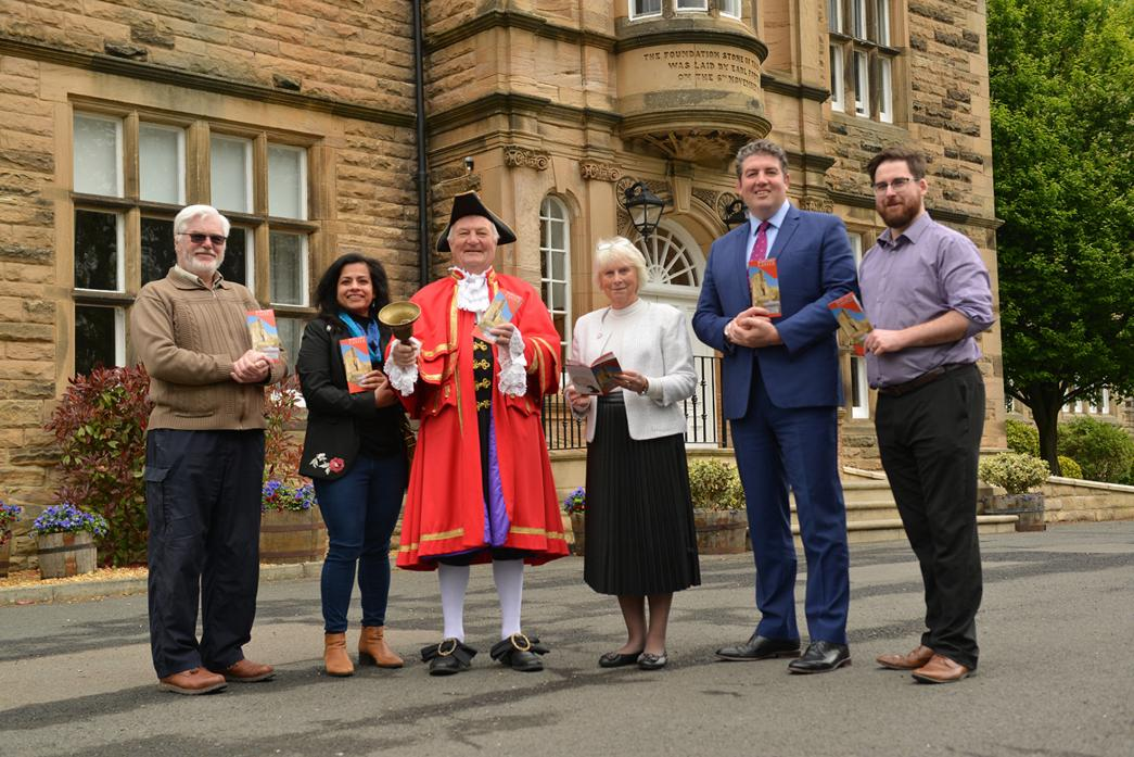 READ ALL ABOUT IT: Promoting Barnard Castle with a new brochure are town councillor Rima Chatterjee, photographer David Williams, town crier Ian Kirkbride, mayor Sandra Moorhouse, Barnard Castle School headmaster Tony Jackson and booklet designer Andy Far