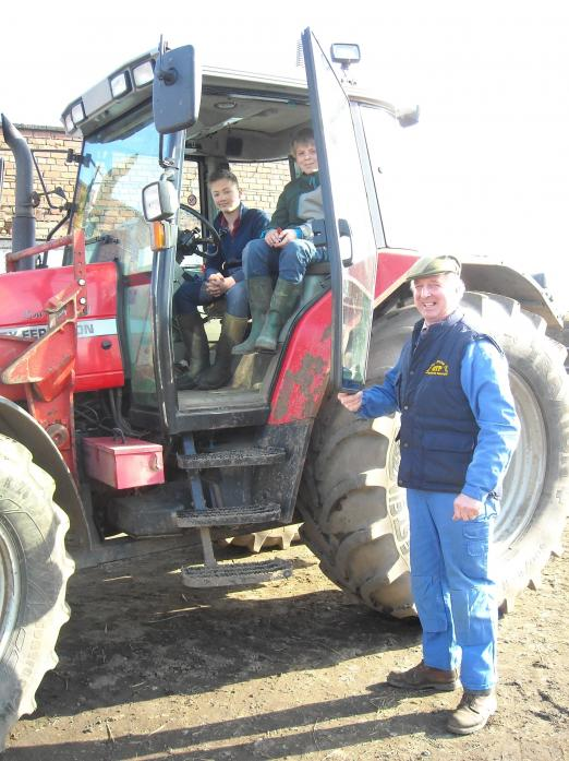 TRACTOR DRIVERS: Jack and Adam with Lantra trainer Terry Maw on one of the courses funded by the Wellesley Trust Fund last year
