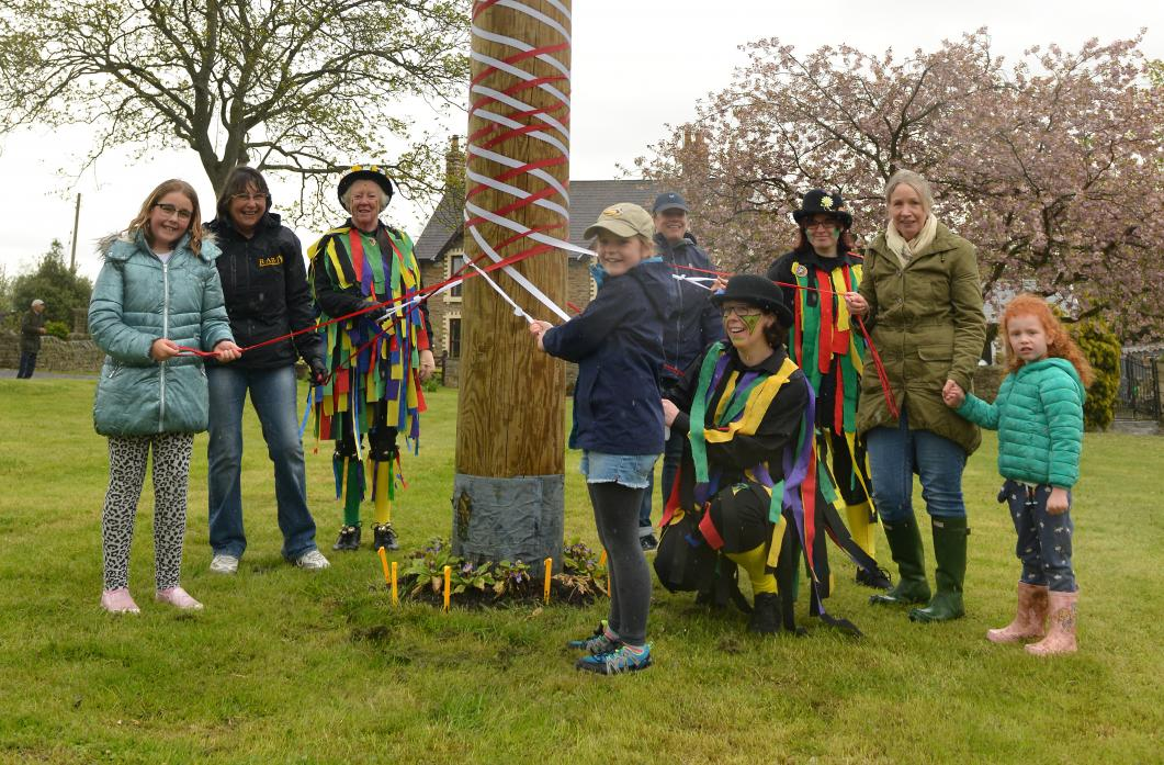 TRADITIONAL FUN: Black Sheep Morris dancers joined in with other maypole dancers to produce a perfect single plait pattern on their first attempt
