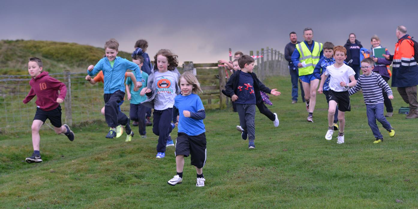 READY, STEADY, GO: Butterknowle Sea Scouts head off on their mud run as a dark cloud gathers ominously overhead