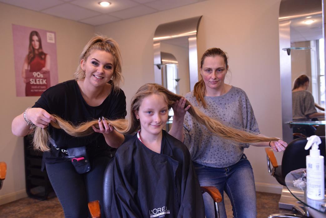 BEFORE: Mum Tracy Gibson, right, and stylist Anna-Lisa Stevenson demonstrate the length of Bella Nicholson's hair