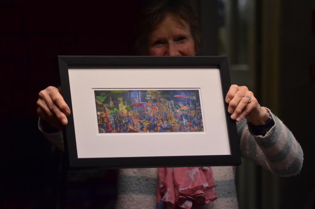 IN PRINT: Jennie White with a print of the Pittuck mural – one of a range of pieces of merchandise available