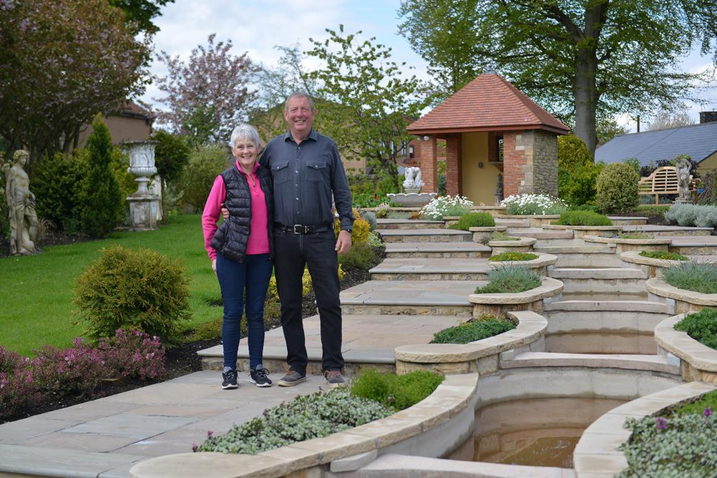 GRAND DESIGNS: Michael Maddison and his partner Pauline Wright in the gardens