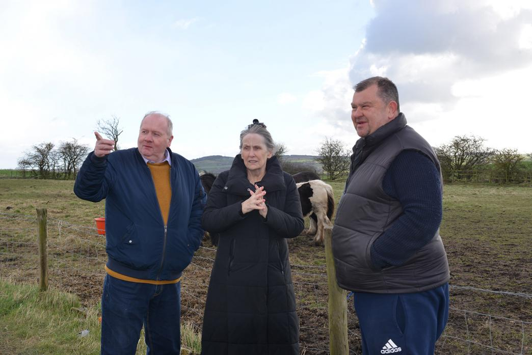 SALE FEARS: Evenwood parish clerk Martin Clark and chairwoman Barbara Nicholson pictured this spring, chatting to allotment holder John Robinson about the potential end of his tenancy Mr Robinson has held an allotment on the Copeland Row site for 32 years