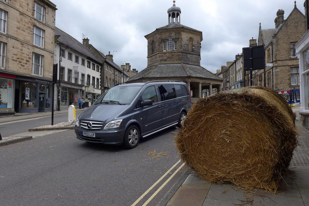 WATCH OUT: The bale was moved to the pavement after it fell off the trailer in the middle of the road near the Market Cross