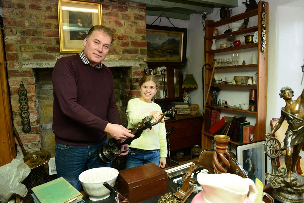 CHIP OFF THE OLD BLOCK: Alastair Donaldson and his daughter Molly examine one of the antiques in their shop