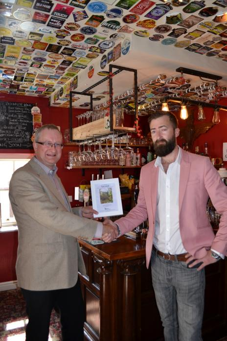NUMBER TWO: Peter Blake presents Jamie Kidd, of the Firkin Alley micro-pub, with his  toilet twinning certificate