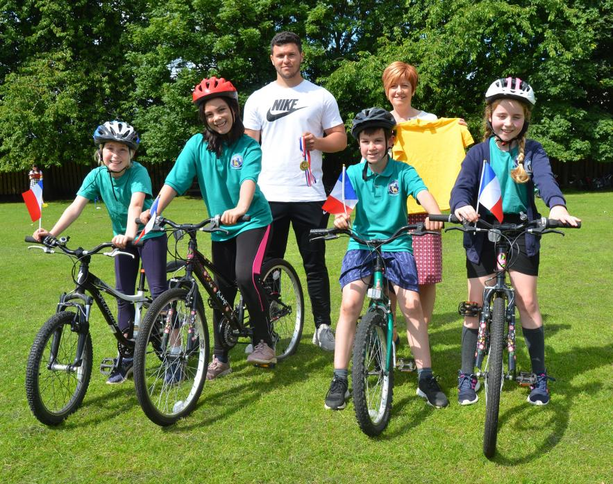 SPORTS EVENT: Deputy head teacher Janet Boyd with teaching assistant James Beauchamp and some of the students who completed the Tour de Staindrop