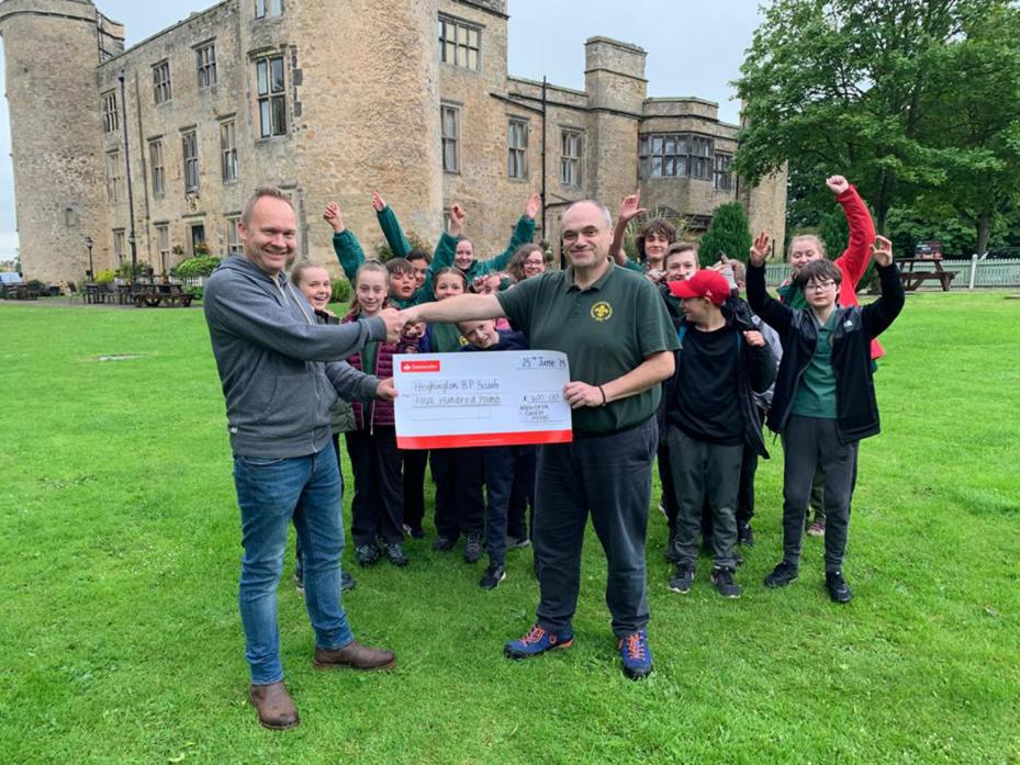 QUIDS IN: Chris Swain, director of Walworth Castle, presents David Greaves, of Heighington Scouts, with a cheque for £400