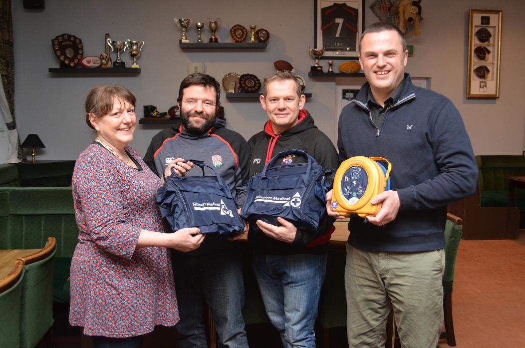 HEALTH BOOST: Coaches Matthew Barber and Paul Davis receive the portable defibrillator and first aid kits from Iris Hillery, secretary of the Friends of Richardson Hospital, and Dr Ian Blain, an A&E consultant at The James Cook University Hospital who als