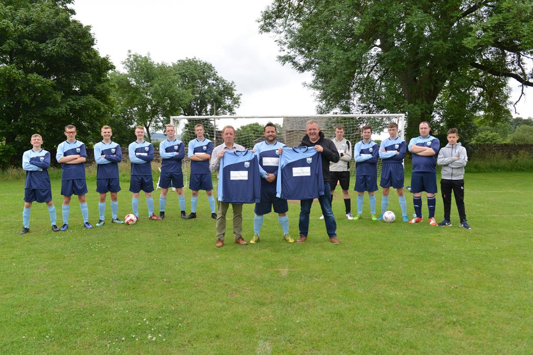 NEW KIT: Nigel and Andy Mitchell present new strips to Middleton-in-Teesdale Football Club manager Dave Short