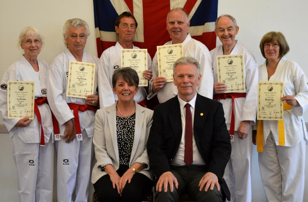 SILVER FIGHTERS: Master grade Klara Whiley, 5th Dan, and Grandmaster Bryan Whiley, 8th Dan, with red belt graduates  Liz Pentland, Terry Robinson, John Johnson, Graham Copley and Cliff Laverick, and yellow belt graduate Mel Kelly