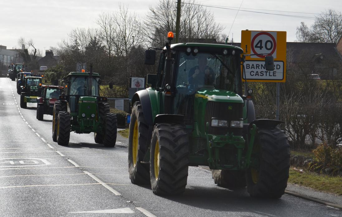 OUT IN FORCE: Tractors head out of Barnard Castle on the rally, which will raise money for Macmillan Cancer Support