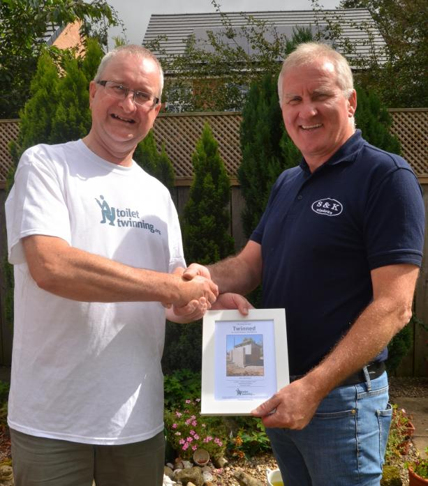 SIGNING UP: Ian Blake, from the Toilet Twinning scheme, presents Steve Darby, of S&K Windows, with a certificate for taking part in the initiative