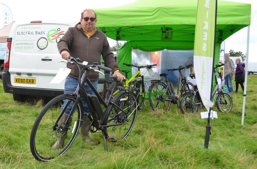 ON YOUR BIKE: John Cockburn-Evans, of Lean2Sustain, shows off one of the battery powered bikes at Brough Show