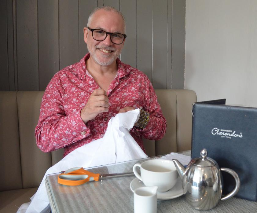 ALL SEWN UP: Richard Bliss enjoys a cuppa at Clarendon's, in Barnard Castle, while working on the shirt he will display as part of an exhibition at The Bowes Museum