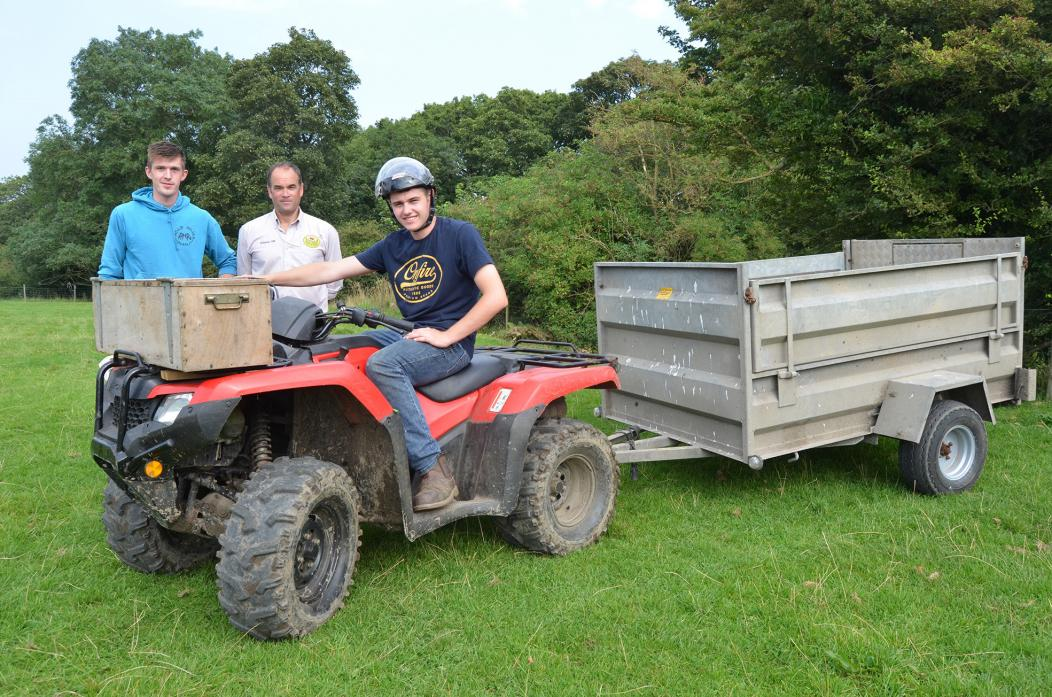 MUCH TO LEARN: Lewis Wearmouth, left, and William Gale, right, got to grips with ATV training with the help of Graeme Gill of Deepdale 4x4
