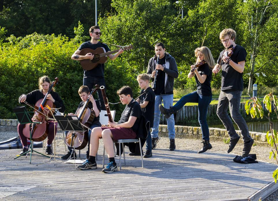 JUMP TO IT: Members of Cream Tees accompanied by tutor Rupert Philbrick perform at one of Whitby's outdoor venues