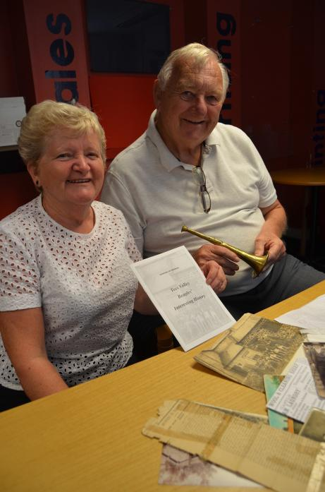 VILLAGE LINK: John Whitfield with his wife, Wendy, with the booklet they created after discovering a long-forgotten newspaper cutting about his grandfather.