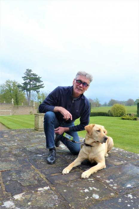 NEW BOOK: Dave Thomas with his guide dog Hannah at their Lartington home