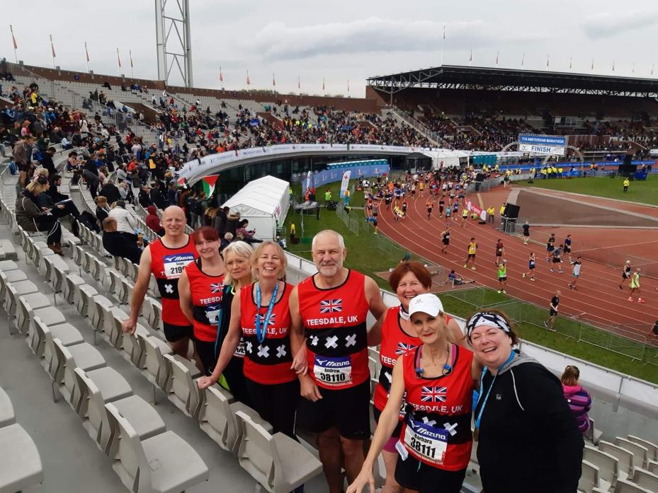 ON THE RUN: In the Olympic stadium, Amsterdam are, from left, Sean Williams, Irene Sutherland, Caroline Moss, Trudy Layton, Andrew Crawley, Amanda Pettitt, Barbara Crawley and Janet Stables