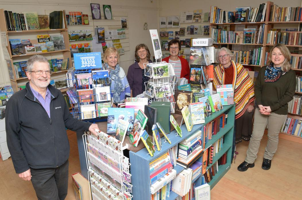LOTS ON OFFER: Village bookshop volunteers Derek Simms, Pauline Black, Cath Maddison, Elizabeth Long, Anna Johnson and Christine Cartwright are looking forward to welcoming customers to see their Christmas range 			    TM pic