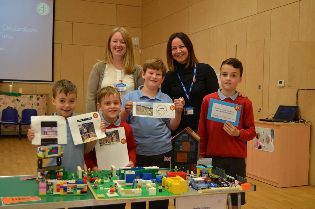 BUILDING BLOCKS: Lego competition winners Joshua, Max, James and Ruben with their Lego masterpieces and teachers Leanne Porter and Lesley Box 			             TM pic